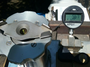 Photo of actual SWP measurement in walnut using a pressure chamber with digital gauge. Plant water status of this walnut tree was -5.67 bars tension (rounded to nearest tenth,-5.7 bars). Photo: C. Haynes.