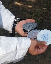 If the pesticide label requires an N95, you can use a half-mask with N95 particulate filters.